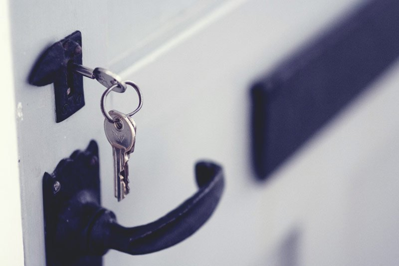 closeup of keys hanging in door lock